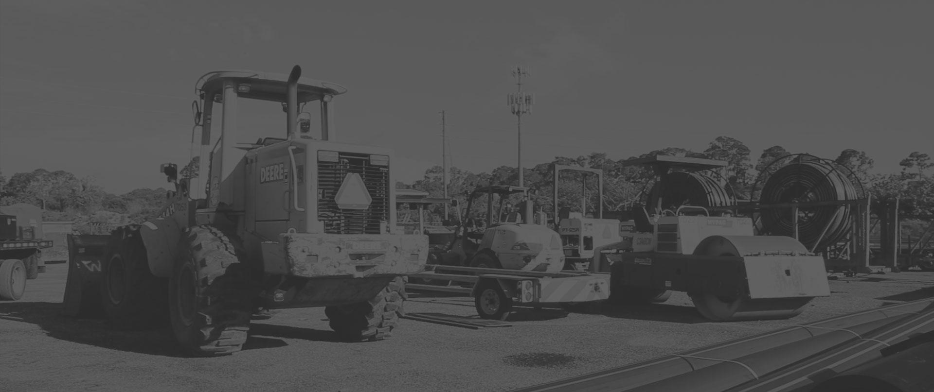 A black and white image of directional drilling equipment including a steamroller.